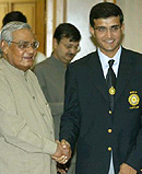 Prime Minister Atal Bihari Vajpayee presents a bat to Indian cricket team captain Sourav Ganguly